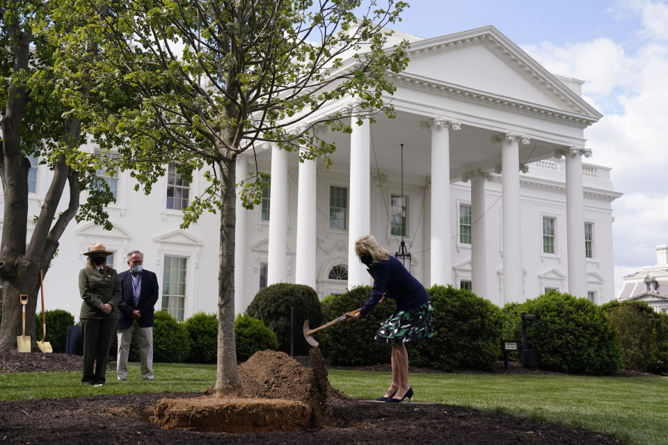 First lady Jill Biden participates in an Arbor Day tree planting ceremony at the White House, Friday, April 30, 2021, in Washington. (AP Photo/Evan Vucci)