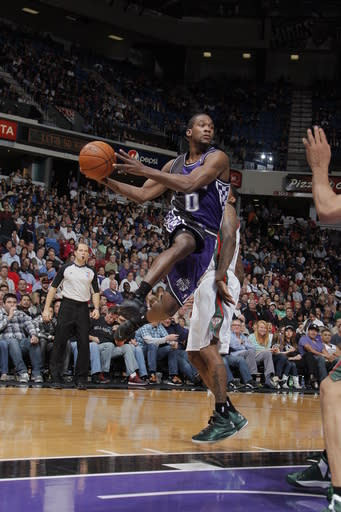 SACRAMENTO, CA - MARCH 10: Toney Douglas #0 of the Sacramento Kings passes the ball against the Milwaukee Bucks on March 10, 2013 at Sleep Train Arena in Sacramento, California. (Photo by Rocky Widner/NBAE via Getty Images)