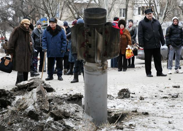 People look at the remains of a rocket shell on a street in the town of Kramatorsk, eastern Ukraine. (Reuters)