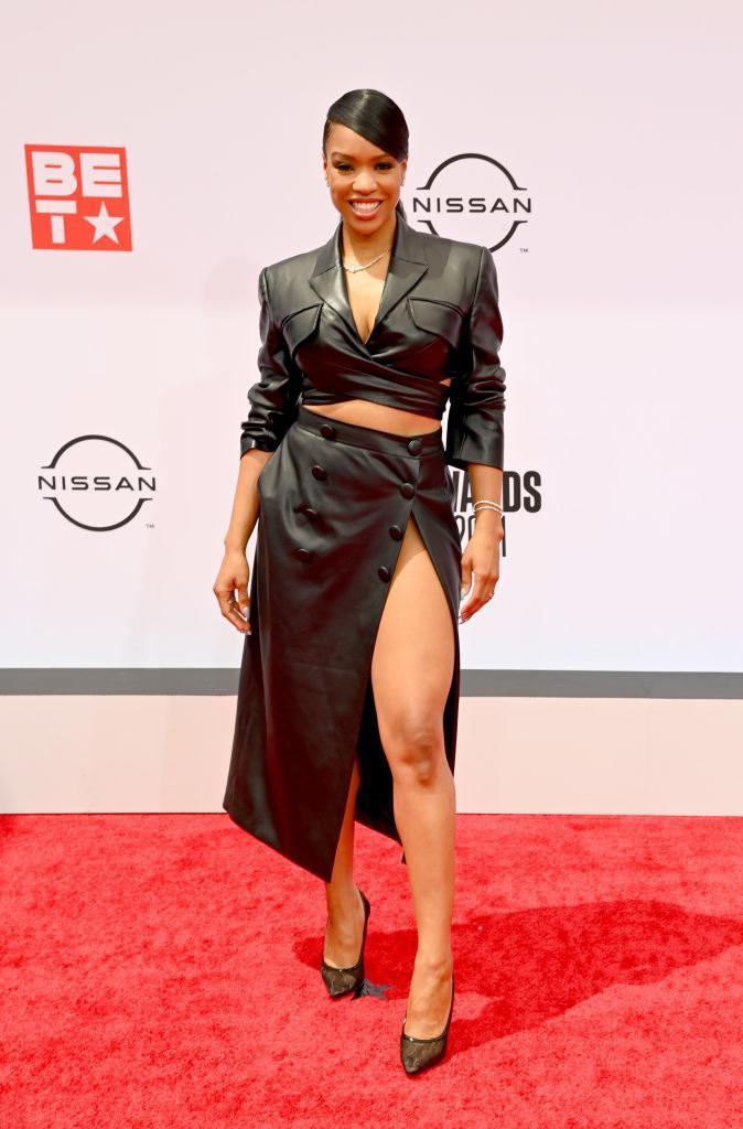 Michelle Mitchenor attends the BET Awards 2021 in a leather cropped jacket and matching skirt