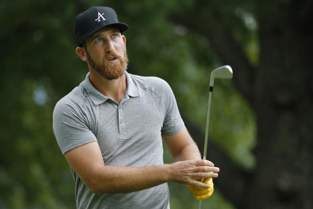 Kevin Chappell watches his tee shot on the ninth hole during the second round of A Military Tribute at The Greenbrier golf tournament in White Sulphur Springs, W.Va., Friday, Sept. 13, 2019. (AP Photo/Steve Helber)