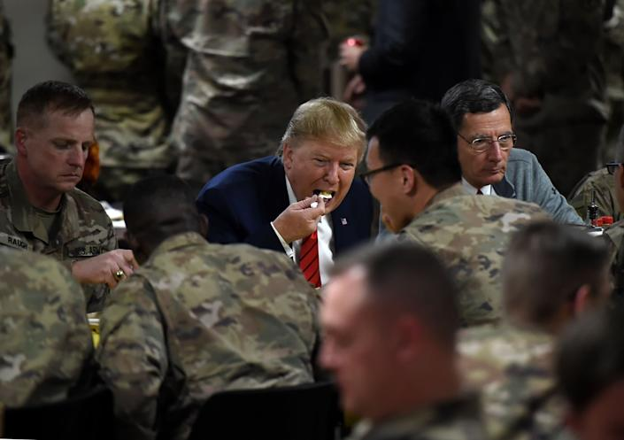 Donald Trump eats Thanksgiving dinner after serving US troops at Bagram airbase during a surprise visit to Afghanistan: AFP via Getty Images