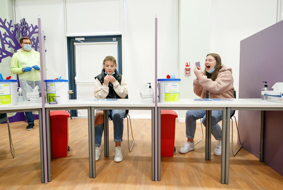 Students Ellie Fisher (left) and Beth Hicks (right) take Coronavirus lateral flow tests at Outwood Academy Adwick in Doncaster (PA) (PA Wire)