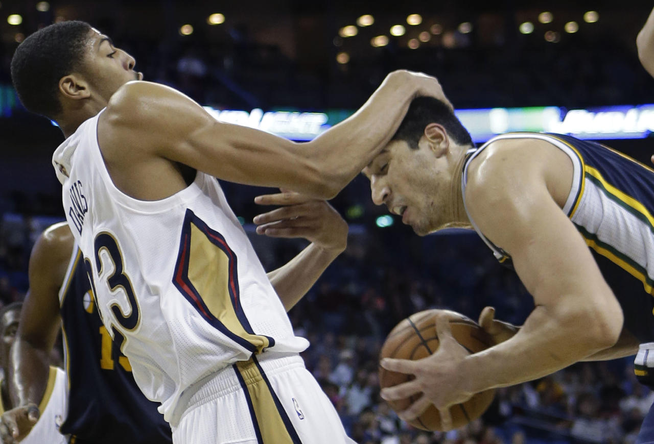 New Orleans Pelicans power forward Anthony Davis, left, battles with Utah Jazz center Enes Kanter, right, in the second half of an NBA basketball game in New Orleans, Wednesday, Nov. 20, 2013.  The Pelicans won 105-98. (AP Photo/Gerald Herbert)
