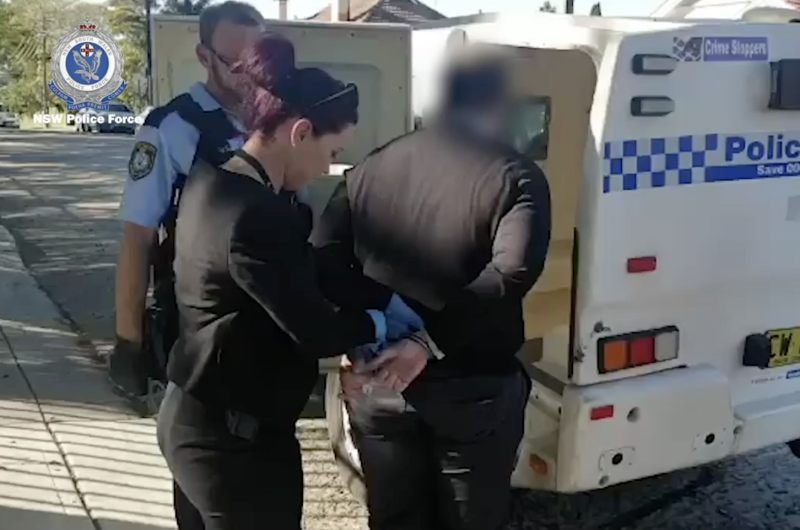 Pictured is the 39-year-old man being placed into handcuffs by police. Source: NSW Police