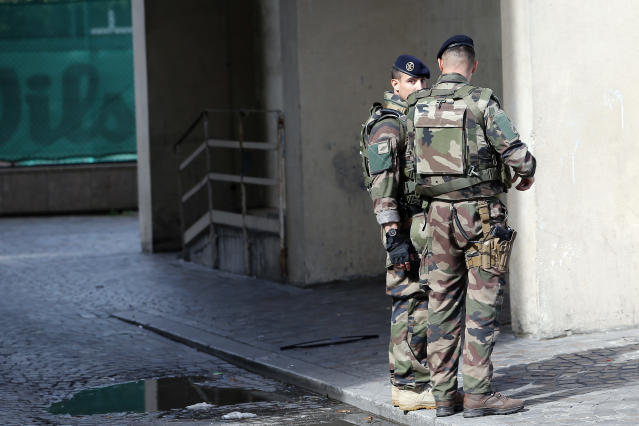 <p>French soldiers stand near the scene where French soldiers were hit and injured by a vehicle in the western Paris suburb of Levallois-Perret near Paris, France, Wednesday, Aug. 9, 2017. (Photo: Kamil Zihnioglu/AP) </p>