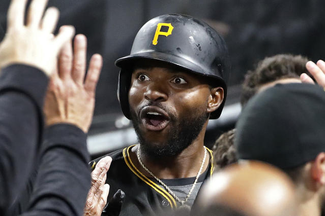 Pittsburgh Pirates' Gregory Polanco celebrates as he returns to the dugout after hitting a solo home run off San Francisco Giants starting pitcher Jeff Samardzija during the third inning of a baseball game in Pittsburgh, Saturday, May 12, 2018. (AP Photo/Gene J. Puskar)