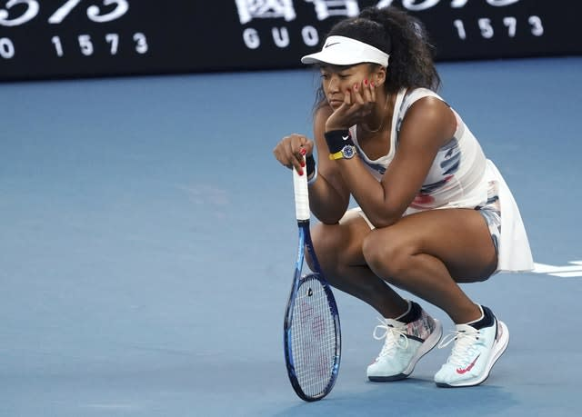 Naomi Osaka looks despondent during her defeat by Coco Gauff (Lee Jin-man/AP)