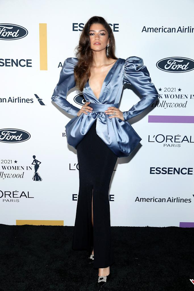 "<p>Zendaya stunned in a 1982 Yves Saint Laurent Couture gown from her stylist Law Roach's personal collection at the ESSENCE Black Women in Hollywood Awards. </p><p>Roach wrote in his <a href=""https://www.instagram.com/p/CN_CkCrDXrV/"" rel=""nofollow noopener"" target=""_blank"" data-ylk=""slk:Instagram post"" class=""link rapid-noclick-resp"">Instagram post</a>, showing the 24-year-old pose in the plunging, peplum, puff-sleeved blue and black gown, that the dress was previously owned by Black entrepreneur and businesswoman Eunice Johnson, noting: 'We pay homage'.</p><p>Johnson co-published Ebony magazine and founded The Ebony Fashion Fair, which highlighted and celebrated the work of Black models and designers across the United States for 50 years. </p>"