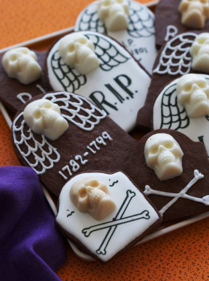 """<p>Put your chocolate cravings to rest with these spooky treats made with chocolate butter cookie dough and white chocolate skulls.</p><p><a href=""""https://www.womansday.com/food-recipes/food-drinks/recipes/a11067/chocolate-tombstone-cookies-recipe-122454/"""" rel=""""nofollow noopener"""" target=""""_blank"""" data-ylk=""""slk:Get the Chocolate Tombstone Cookies recipe."""" class=""""link rapid-noclick-resp""""><strong><em>Get the Chocolate Tombstone Cookies recipe.</em></strong></a></p>"""