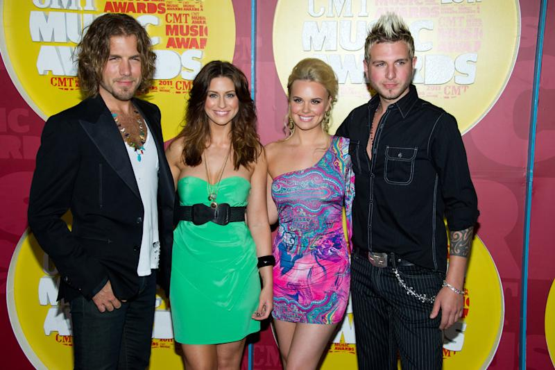 FILE - In this June 8, 2011 file photo, members of the band Gloriana, from left, Mike Gossin, Rachel Reinert, Cheyenne Kimball and Tom Gossin arrive at the 2011 CMT Music Awards in Nashville, Tenn. Kimball  announced the her departure from the group Saturday, July 9, on Gloriana's Twitter account. That tweet has since been erased, but spokesman Paul Freundlich confirmed Kimball's departure Monday and the band put a statement on its website. (AP Photo/Charles Sykes, file)