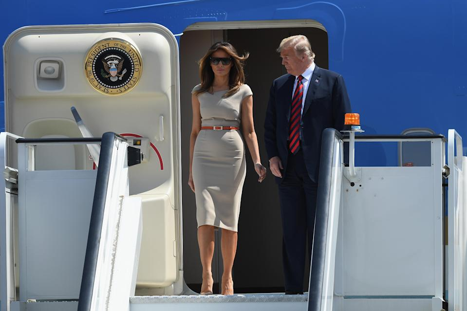 The first couple landed in England, with Melania taking a fashion cue from Meghan Markle. (Photo: Getty Images)