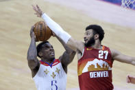 New Orleans Pelicans guard Eric Bledsoe (5) shoots as Denver Nuggets guard Jamal Murray (27) defends during the second half of an NBA basketball game in New Orleans, Friday, March 26, 2021. (AP Photo/Rusty Costanza)