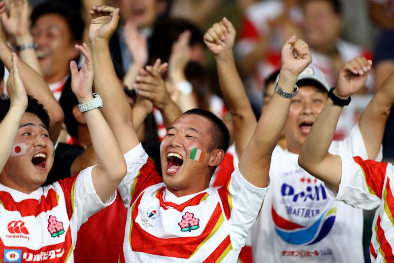 Japan fans celebrate their stunning success against Ireland