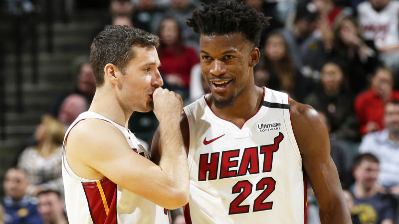 Jimmy Butler, pictured speaking to Miami Heat teammate Goran Dragic, has upped his rebounding and assist numbers.