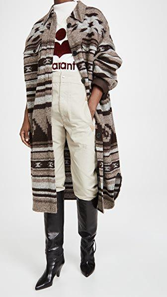 "<p><strong>Isabel Marant Etoile</strong></p><p>shopbop.com</p><p><strong>$447.00</strong></p><p><a href=""https://go.redirectingat.com?id=74968X1596630&url=https%3A%2F%2Fwww.shopbop.com%2Fgabrion-coat-isabel-marant-etoile%2Fvp%2Fv%3D1%2F1504852441.htm&sref=https%3A%2F%2Fwww.townandcountrymag.com%2Fstyle%2Ffashion-trends%2Fg29302944%2Fstatement-coats-for-winter%2F"" rel=""nofollow noopener"" target=""_blank"" data-ylk=""slk:Shop Now"" class=""link rapid-noclick-resp"">Shop Now</a></p><p>Isabele Marant's sweater coats are style classics for a reason. The print, hues, and length of this knit make it a piece that could work for a casual outfit, but also a cool-factor addition to a slightly dressier look.</p>"