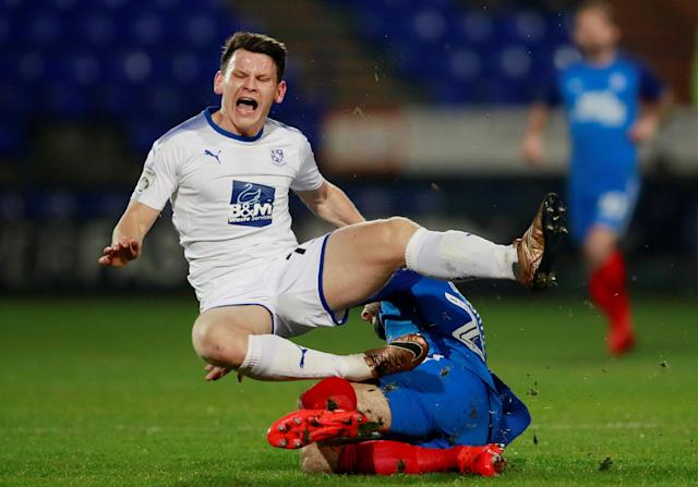 Soccer Football - FA Cup First Round Replay - Tranmere Rovers vs Peterborough United - Prenton Park, Birkenhead, Britain - November 15, 2017 Peterborough United's Michael Doughty in action with Tranmere Rovers' Connor Jennings Action Images/Jason Cairnduff