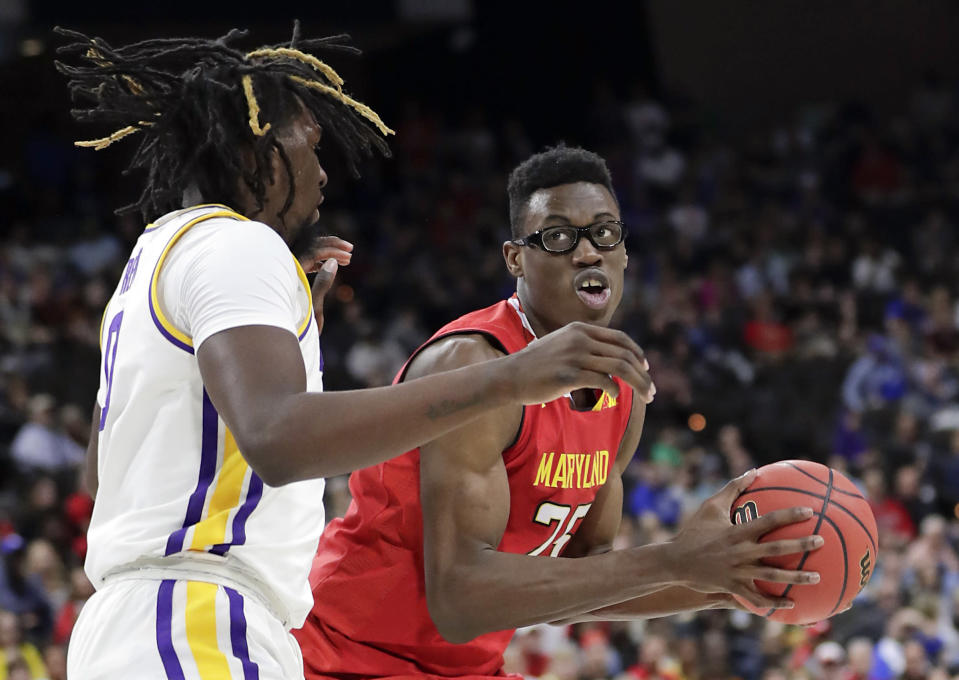 <p>Maryland's Jalen Smith, right, looks for a shot against LSU's Naz Reid during the first half of a second-round game in the NCAA men's college basketball tournament in Jacksonville, Fla., Saturday, March 23, 2019. (AP Photo/John Raoux) </p>