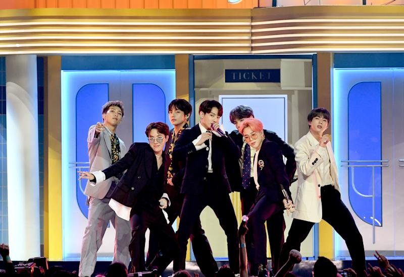 BTS singers adorn in co-operate outfits as they perform on stage