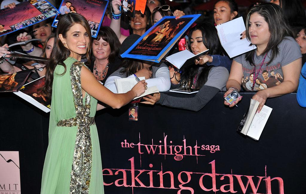 "Nikki Reed greets fans at the red carpet premiere for ""The Twilight Saga: Breaking Dawn – Part 1"" in Los Angeles, CA. (Photo by Vince Bucci/Yahoo!)"