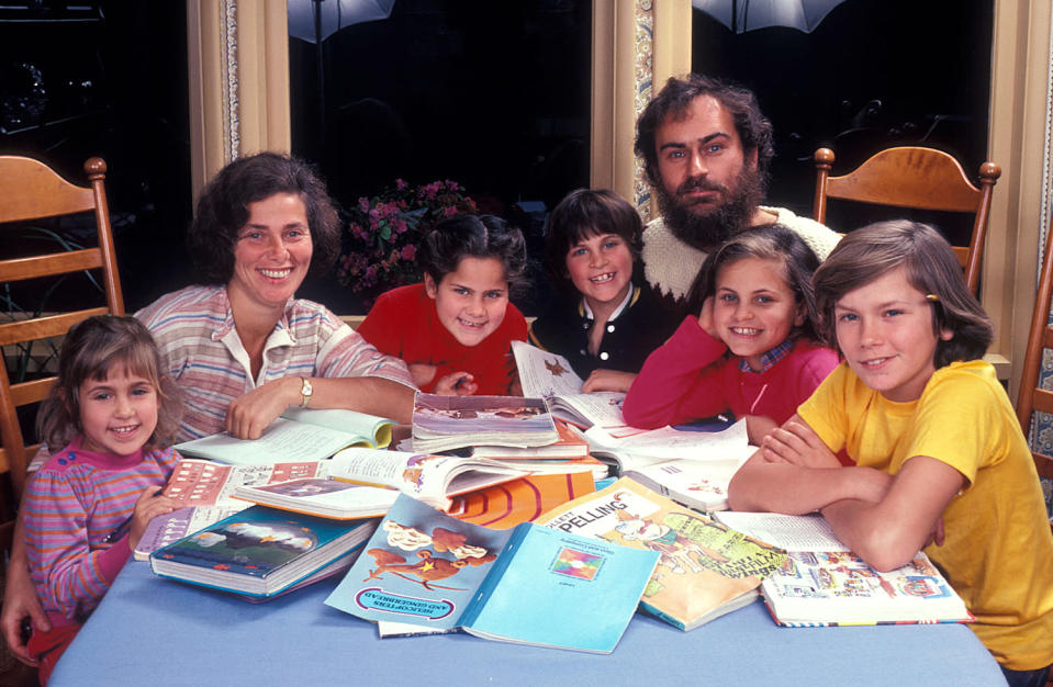 """<p>Recognize the child fourth from the left? That's actor Joaquin Phoenix as a boy with his family in their Los Angeles home. His brother, River, who <a href=""""https://people.com/movies/inside-the-life-of-river-phoenix-the-beloved-actor-who-died-at-23/"""" rel=""""nofollow noopener"""" target=""""_blank"""" data-ylk=""""slk:tragically died of a drug overdose"""" class=""""link rapid-noclick-resp"""">tragically died of a drug overdose</a> in October 1993, in farthest right. The photo was taken by Dianna Whitley. </p>"""
