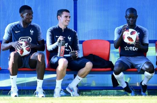 France players Paul Pogba, Antoine Griezmann and N'Golo Kante take a break from preparations for the World Cup final