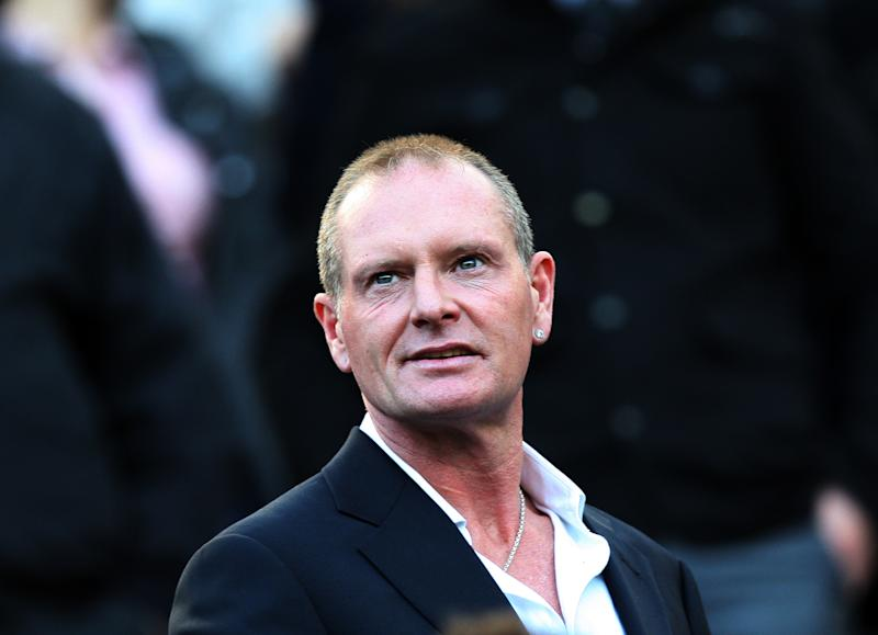 FILE - In this Oct. 16, 2011 file photo, Paul Gascoigne, is seen at the English Premier League soccer match between Newcastle United and Tottenham Hotspurs at St James' Park, Newcastle, England. According to news reports published Sunday March 10, 2013, Gascoigne says he's back from brink of death after receiving treatment for alcoholism in USA. The 45-year-old Gascoigne flew back home on Saturday, a month after being admitted to the intensive care unit of a hospital in Phoenix, USA, following a relapse in his long-running struggle with alcoholism. (AP Photo/Scott Heppell, File)