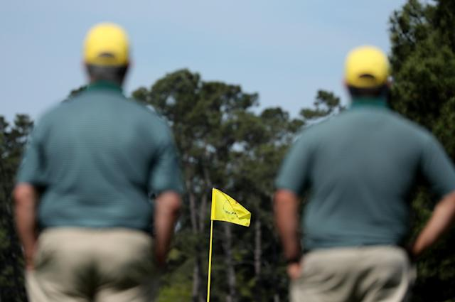 Augusta National gallery workers look out at the course during practice for the 2018 Masters golf tournament at Augusta National Golf Club in Augusta, Georgia, U.S. April 2, 2018. REUTERS/Lucy Nicholson