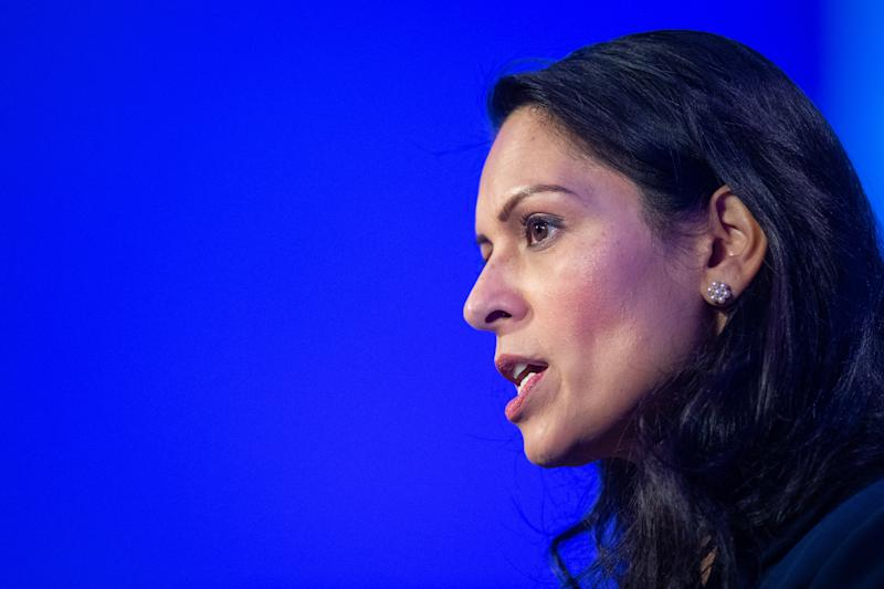 Home Secretary Priti Patel delivers a speech during the National Police Chiefs' Council and Association of Police and Crime Commissioners joint summit, at the Queen Elizabeth II Conference Centre, in London.