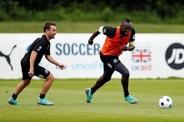 Soccer Football - England & Soccer Aid World XI Training - Motspur Park, London, Britain - June 7, 2018 Soccer Aid World XI's Usain Bolt and Martin Compston during training Action Images via Reuters/Andrew Boyers