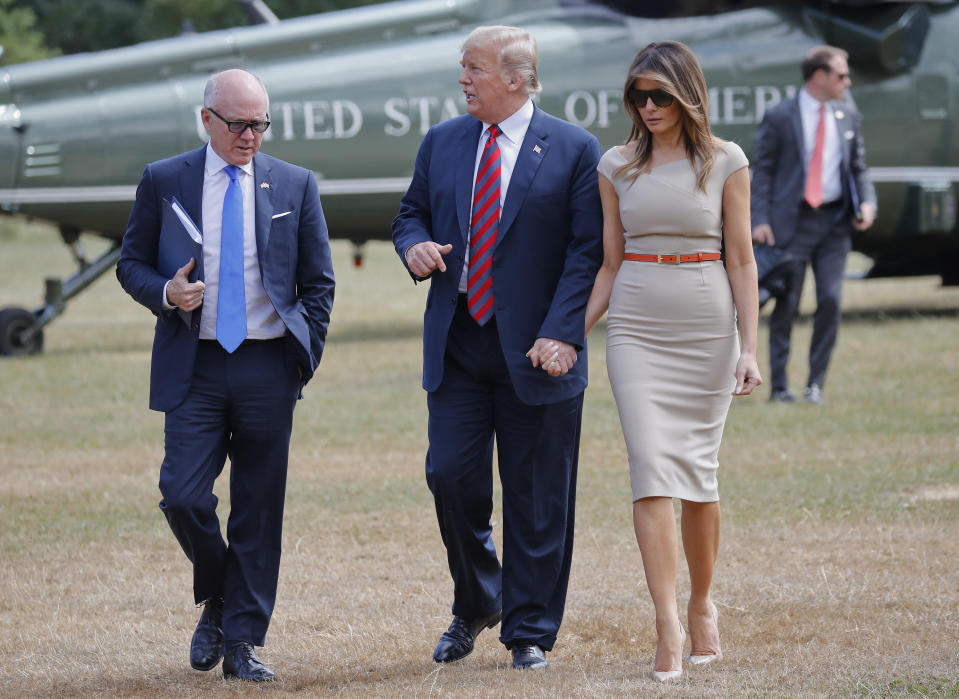President Donald Trump, center, and first lady Melania Trump, right, walk with Woody Johnson, left, United States Ambassador to the United Kingdom in 2018. (AP Photo/Pablo Martinez Monsivais)