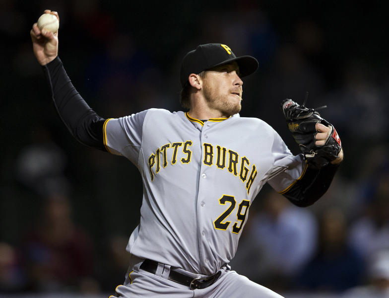 Pittsburgh Pirates' Kevin Correia (29) pitches against the Chicago Cubs during the first inning of a baseball game, Monday, Sept. 17, 2012, in Chicago. (AP Photo/Jim Prisching)