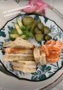 """<p>Recently, Kourtney swapped out her go-to salad lunch for a simple <a href=""""https://poosh.com/kourtney-kardashian-new-lunch-menu/"""" rel=""""nofollow noopener"""" target=""""_blank"""" data-ylk=""""slk:toasted turkey sandwich"""" class=""""link rapid-noclick-resp"""">toasted turkey sandwich</a>. The reality star supplemented it with a mixture of healthy sides, like pickles, clementines slices, and avocado. </p>"""