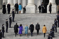 President-elect Joe Biden, his wife Jill Biden and Vice President-elect Kamala Harris and her husband Doug Emhoff arrive at the steps of the U.S. Capitol for the start of the official inauguration ceremonies, in Washington, Wednesday, Jan. 20, 2021. Speaker of the House, Nancy Pelosi waits at left. (AP Photo/J. Scott Applewhite)