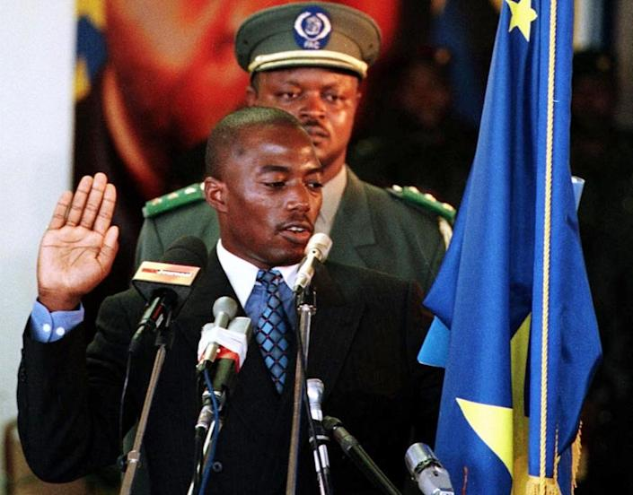 Joseph Kabila takes the oath of office to succeed their slain father as president of the war-wracked and impoverished Democratic Republic of Congo in January 2001 in Kinshasa (AFP Photo/Desirey Minkoh)