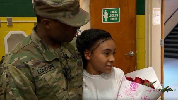 PHOTO: Alexus London, 10, was in gym class at William Rall Elementary School in Lindenhurst on Friday afternoon when her father, Army Staff Sergeant Daniel London, walked in carrying flowers. (WABC)
