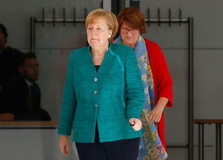 German Chancellor Angela Merkel walks at the fraction level of the German lower house of parliament Bundestag in Berlin, Germany June 14, 2018. REUTERS/Michele Tantussi