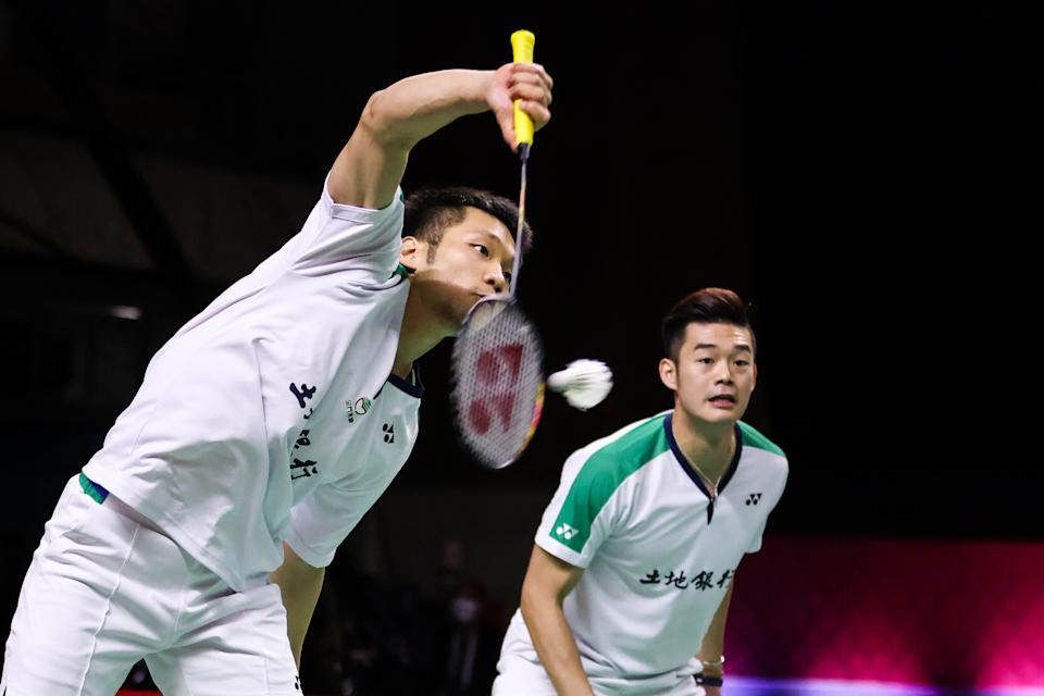 NONTHABURI, THAILAND - JANUARY 31: Lee Yang (L) and Wang Chi-Lin of Chinese Taipei compete in the Men's Double final match against Mohammad Ahsan and Hendra Setiawan of Indonesia on day five of the HSBC BWF World Tour Finals at the IMPACT Arena on January 31, 2021 in Nonthaburi, Thailand. (Photo by Shi Tang/Getty Images)