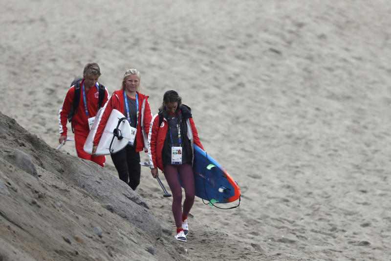 Canada surfers arrive to train one day before competing in the Pan American Games women's short board surfing competition on Punta Rocas beach in Lima, Peru, Sunday, July 28, 2019. Surfing is featured for the first time in the Pan Am Games. (AP Photo/Silvia Izquierdo)