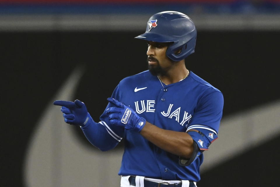Toronto Blue Jays' Marcus Semien gestures to the dugout after hitting a double against the Cleveland Indians during the sixth inning of a baseball game Thursday, Aug. 5, 2021, in Toronto. (Jon Blacker/The Canadian Press via AP)