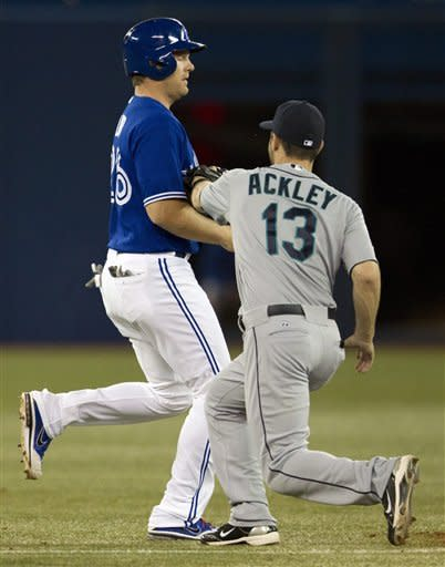 Toronto Blue Jays Adam Lind is caught in a run down by Seattle Mariners second baseman Dustin Ackley during third inning AL action in Toronto on Saturday April 28, 2012. (AP Photo/The Canadian Press, Frank Gunn)