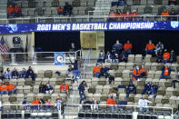 A limited number of fans watch a first round NCAA college basketball tournament game Friday, March 19, 2021, between Drexel and Illinois in Indianapolis. No bands. No cheer squad. No buildings filled with neutral fans suddenly throwing their support behind a plucky double-digit underdog hoping to pull off an upset. This is a decidedly different NCAA tournament experience for players and coaches when they get on the court. (AP Photo/Charles Rex Arbogast)