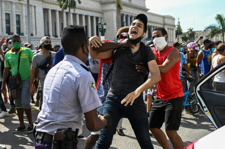 """On July 11 and 12, thousands of Cubans took to the streets in 40 cities around the island shouting """"Freedom,"""" """"Down with the dictatorship,"""" and """"We're hungry"""""""