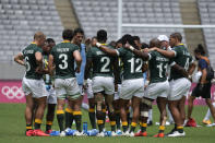 South Africa's team huddles up at halftime in their men's rugby sevens match against the United States, at the 2020 Summer Olympics, Tuesday, July 27, 2021 in Tokyo, Japan. (AP Photo/Shuji Kajiyama)