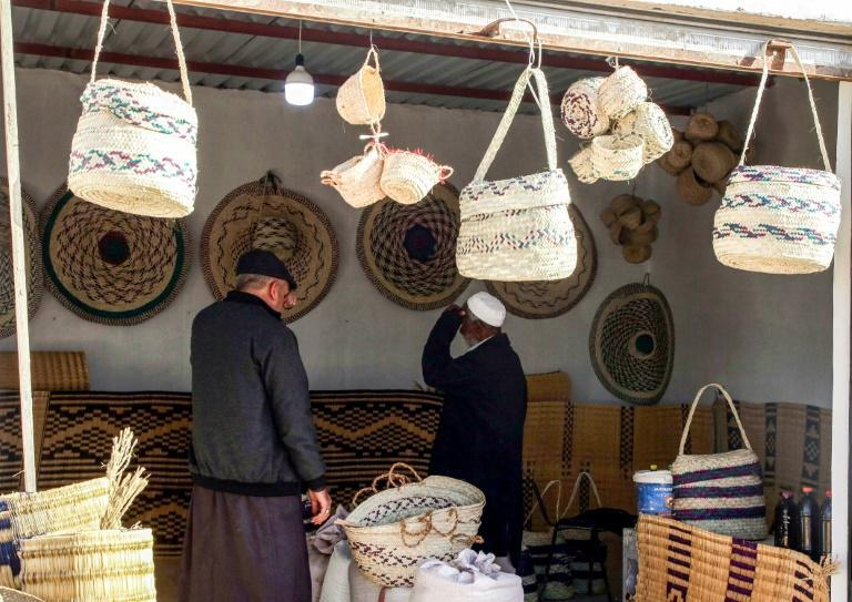 Customers inspect palm wicker products