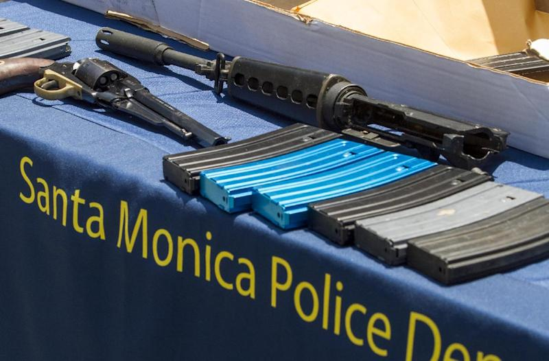 In this Saturday June 8, 2013 file photo weapons recovered from Santa Monica College are displayed during a news conference held by Santa Monica Police in Santa Monica, Calif. The assault-style rifle used by a Santa Monica gunman to kill five people last week appears to have been put together using component parts. Two officials briefed on the investigation who spoke on condition of anonymity say the semi-automatic weapon appears to be built with parts that are legal to obtain, but put together make the rifle illegal in Calif. (AP Photo/Ringo H.W. Chiu, File)