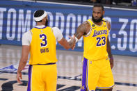 Los Angeles Lakers' Anthony Davis (3) and LeBron James (23) shake hands in the final moments of their 114-108 win over the Denver Nuggets in an NBA conference final playoff basketball game Thursday, Sept. 24, 2020, in Lake Buena Vista, Fla. (AP Photo/Mark J. Terrill)
