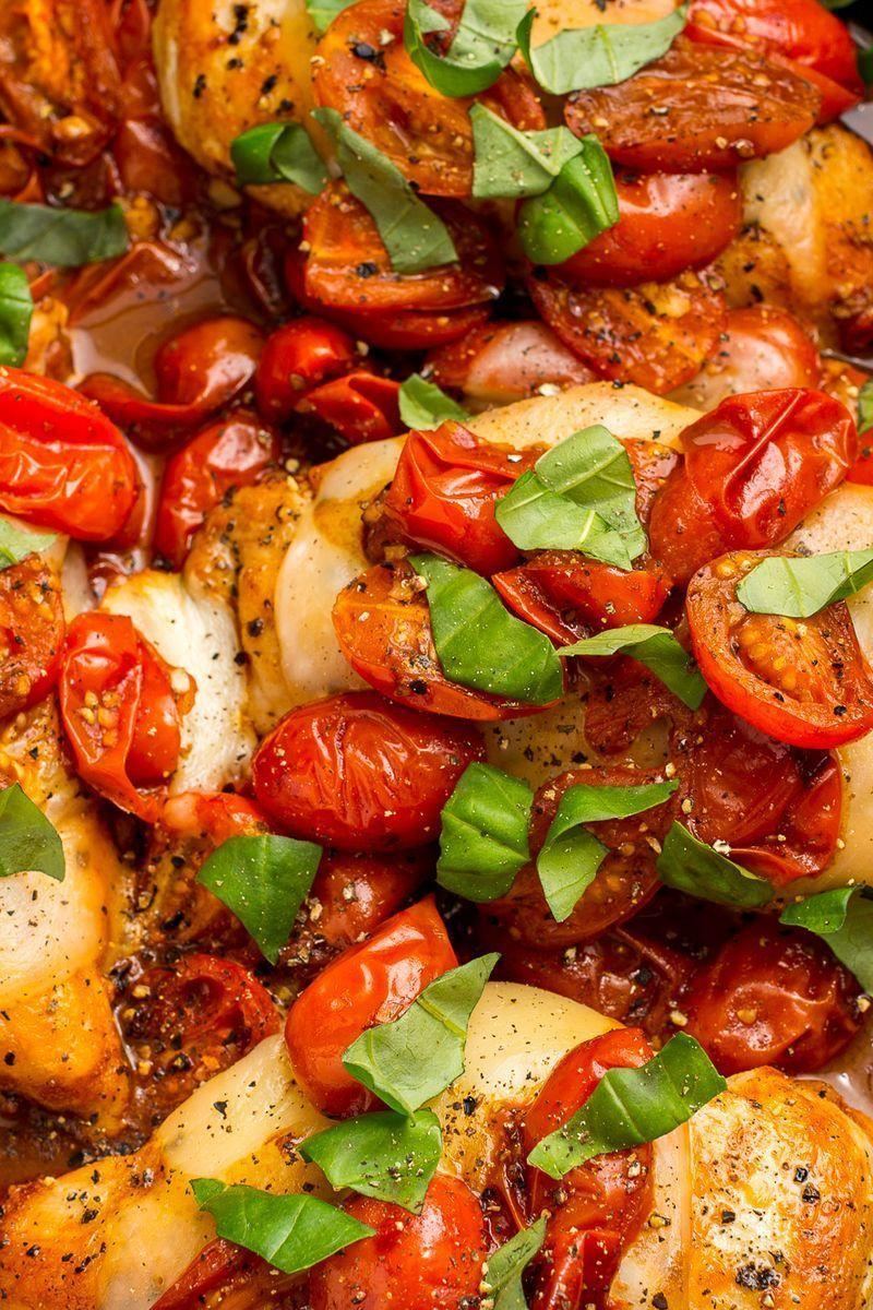 """<p>Tomatoes cooked in balsamic vinegar are the perfect sweet-tart compliment to this cheesy chicken. </p><p>Get the <a href=""""https://www.delish.com/uk/cooking/recipes/a29018750/caprese-chicken-recipe/"""" rel=""""nofollow noopener"""" target=""""_blank"""" data-ylk=""""slk:Caprese Chicken"""" class=""""link rapid-noclick-resp"""">Caprese Chicken</a> recipe.</p>"""