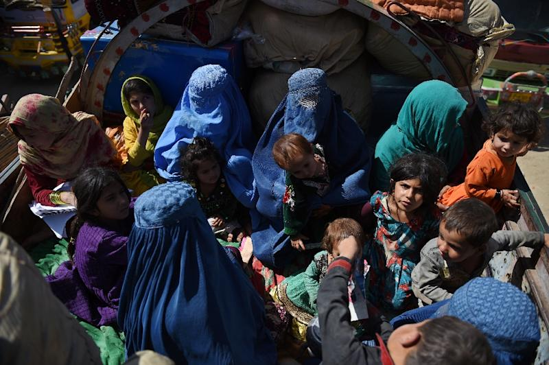 Afghan refugee families sit in a truck as they return from Pakistan to the United Nations High Commissioner for Refugees (UNHCR) camp on the outskirts of Kabul on September 27, 2016 (AFP Photo/Wakil Kohsar)