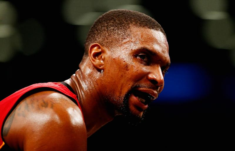 Heat officially waive Bosh, will retire his number one jersey
